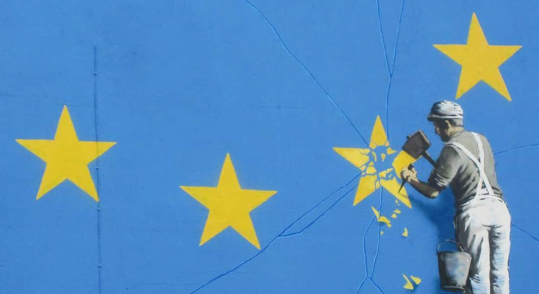 What does Brexit mean for us? Workman chips away a star on the EU flag.