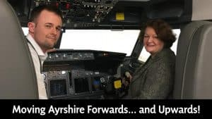 Dr Philippa Whitford, SNP MP for the Central Ayrshire constituency, sitting in a flight simulator at Prestwick Airport. The article relates to the Ayrshire Growth Deal.