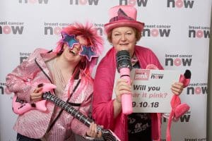 Dr Philippa Whitford MP and colleague posing in pink to promote Breast Cancer Now's Wear it Pink day