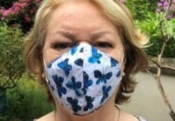 Dr Whitford wears a face covering to help prevent the spread of Covid-19